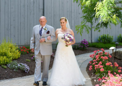 Bride Walks with Her Father