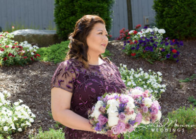 Maid of Honor Holding Flowers
