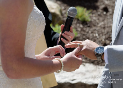 Bride Holding Wedding Ring for Groom